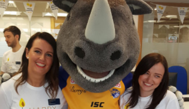 branch colleagues pose for picture with Leeds Rhinos mascot - Ronnie the Rhino